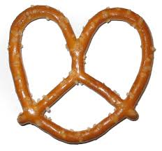 A traditional knot-like pretzel covered with salt is not something a dog can eat — the excessive salt makes it dangerous for dogs.